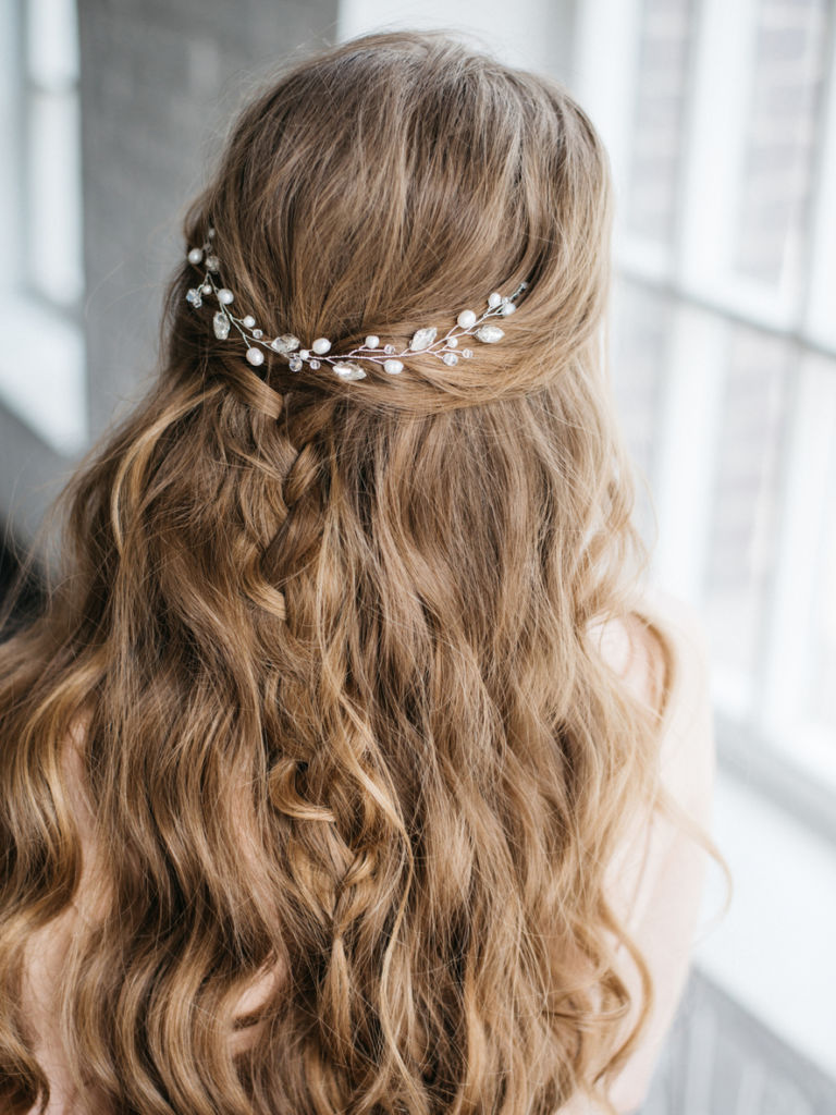 Young beautiful woman with long blond hair decorated by pearl hair jewelry
